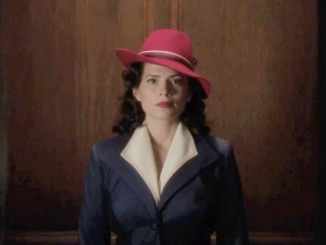Note: in searching for an iconic image to encapsulate Agent Carter, it was incredibly difficult not to find one of her simply pointing a gun at the screen. I think this says something about what we require as a culture of our leading ladies. I much prefer this screenshot of her and her very jaunty hat. -Laney